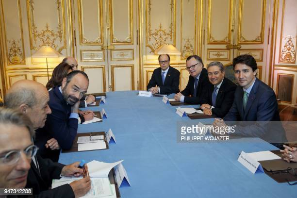 French Prime Minister Edouard Philippe and Canadian Prime Minister Justin Trudeau attend a meeting at the Hotel Matignon in Paris, on April 17, 2018....