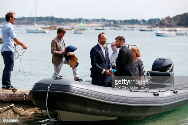 French Prime Minister Edouard Philippe and Ecology Minister Nicolas Hulot embark aboard a speed boat in order to catch the selfenergy producing...