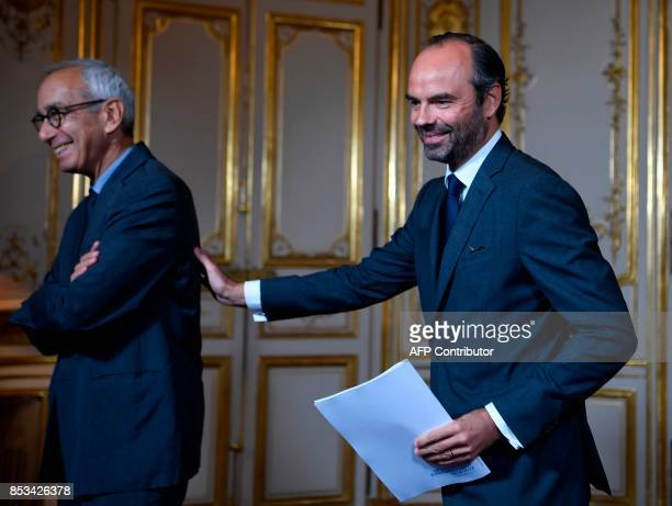 French Prime Minister Edouard Philippe and French economist Jean PisaniFerry react following a report by PisaniFerry on the Grand Investment Plan on...