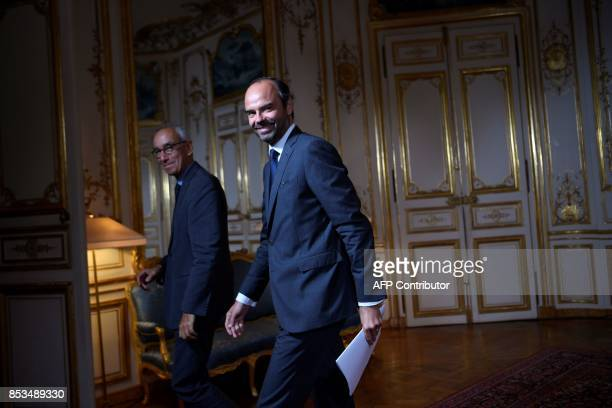 French Prime Minister Edouard Philippe and French economist Jean PisaniFerry leave following a report by PisaniFerry on the Grand Investment Plan on...