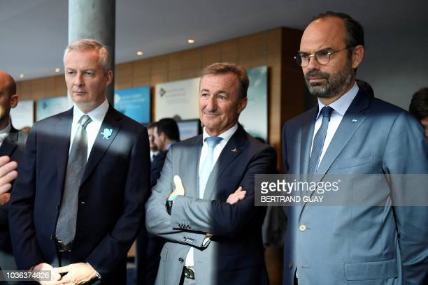 French Prime Minister Edouard Philippe and French Economy Minister Bruno Le Maire listen to general director of Dassault System Bernard Charles as...
