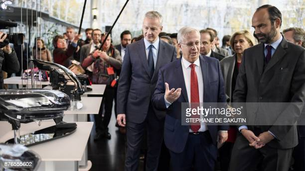 French Prime Minister Edouard Philippe and French Economy Minister Bruno Le Maire listen to France's multinational automotive supplier Valeo Chairman...