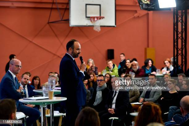 French Prime Minister Edouard Philippe and French Education and Youth Affairs Minister Jean-Michel Blanquer attend a debate with teachers over French...