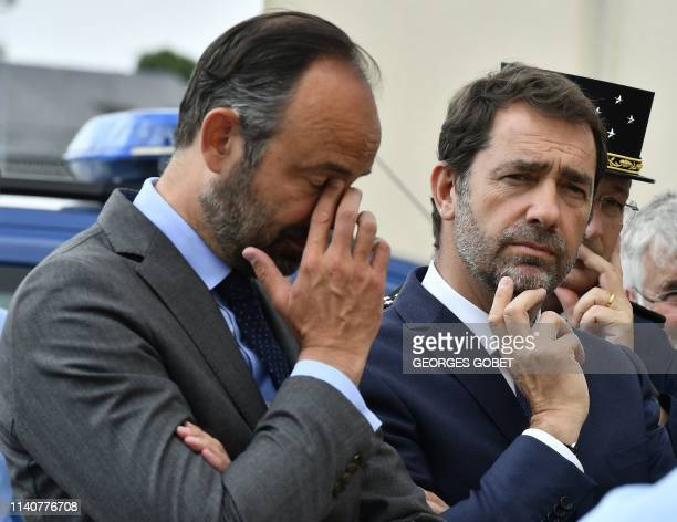 French Prime Minister Edouard Philippe and French Interior Minister Christophe Castaner listen explanations during a visit a gendarmerie station in...