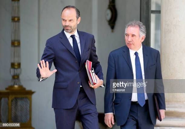 French Prime Minister Edouard Philippe and French Justice minister Francois Bayrou leave the Elysee Presidential Palace after a weekly cabinet...