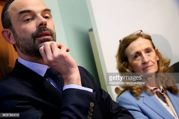 French Prime Minister Edouard Philippe and French Justice Minister Nicole Belloubet meet magistrates at the Tribunal de grande instance of Reims as...