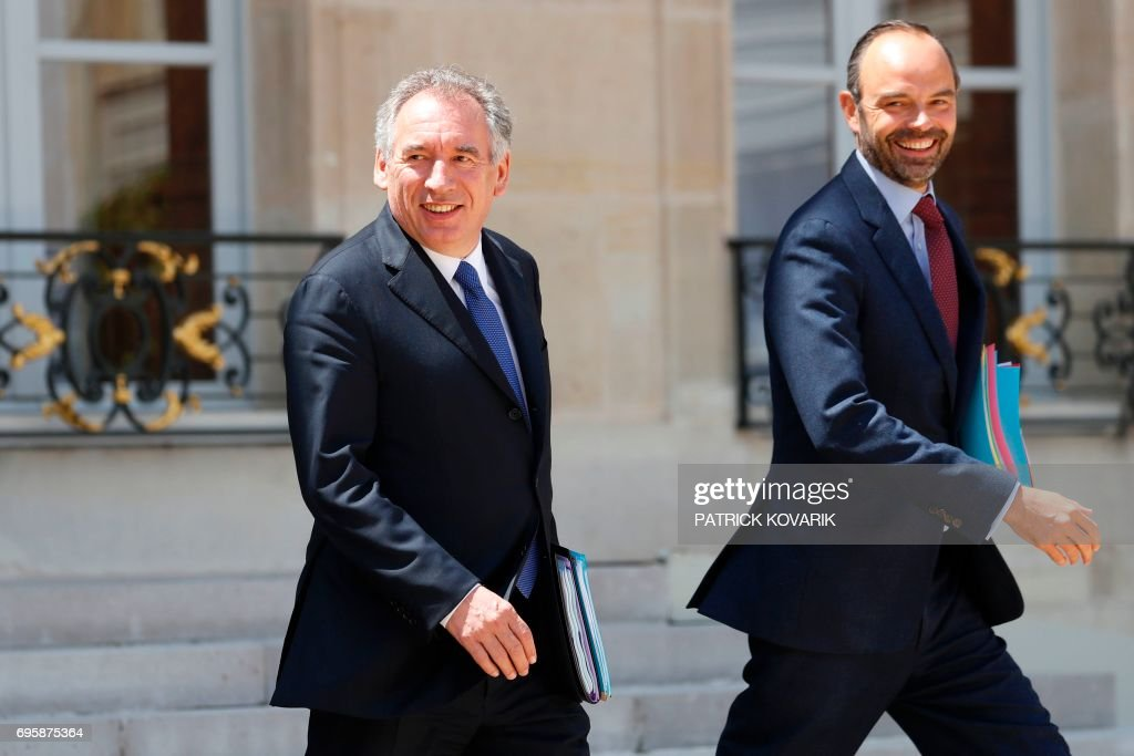 French Prime Minister Edouard Philippe (R) and French Minister of Justice Francois Bayrou (L) leave a cabinet meeting on June 14, 2017 at the Elysee Palace, in Paris. / AFP PHOTO / Patrick KOVARIK