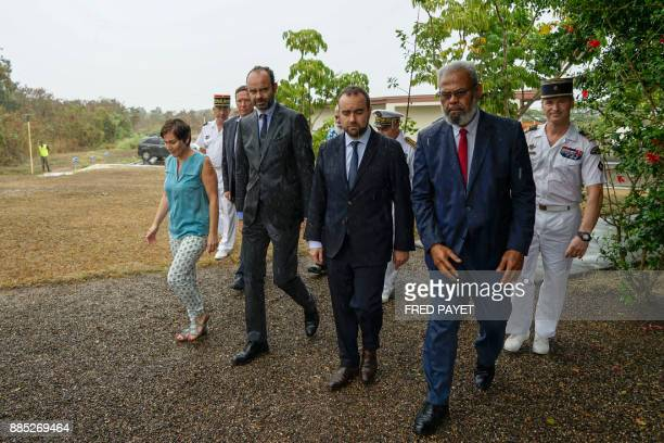 French Prime Minister Edouard Philippe and French Overseas Minister Annick Girardin arrive to review troops during a visit of a military base in...