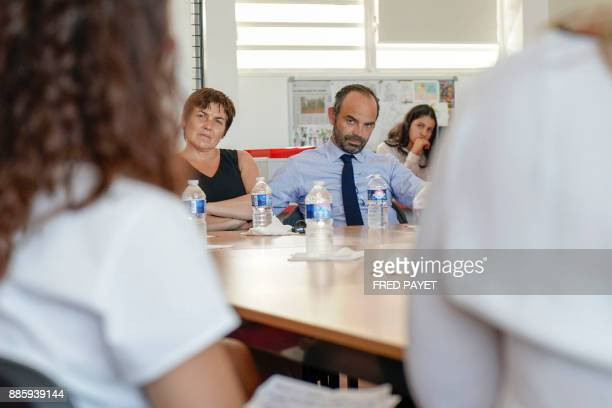 French Prime Minister Edouard Philippe and French Overseas Minister Annick Girardin meet with high school students during the inauguration of a high...