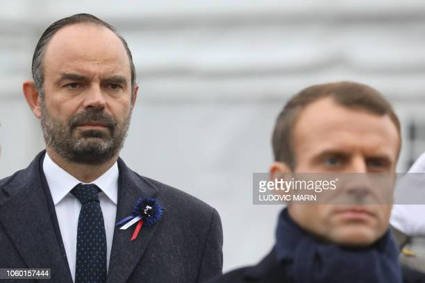 French Prime Minister Edouard Philippe and French President Emmanuel Macron attend in a ceremony at the Arc de Triomphe in Paris on November 11 2018...