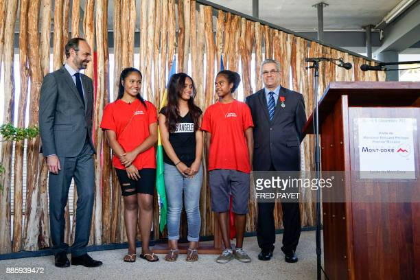 French Prime Minister Edouard Philippe and MontDore mayor Eric Gay pose with high school students during a decoration ceremony for Gay within the...