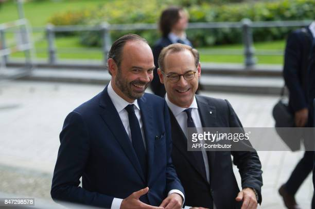 French Prime Minister Edouard Philippe and Oliver Baete CEO of the German insurer Allianz SE arrive at Allianz Forum in Berlin on September 15 2017 /...