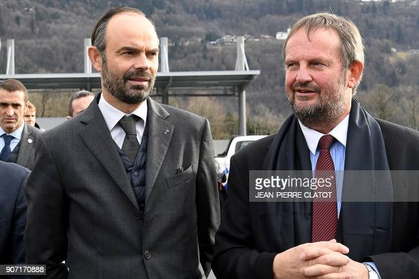 French Prime Minister Edouard Philippe and President of the cable transport company POMA Jean Souchal arrive to inaugurate the new POMA industrial...