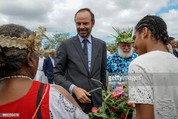 French Prime Minister Edouard Philippe and the president of the North Province of New Caledonia Paul Neaoutyine take part in a welcoming ceremony in...