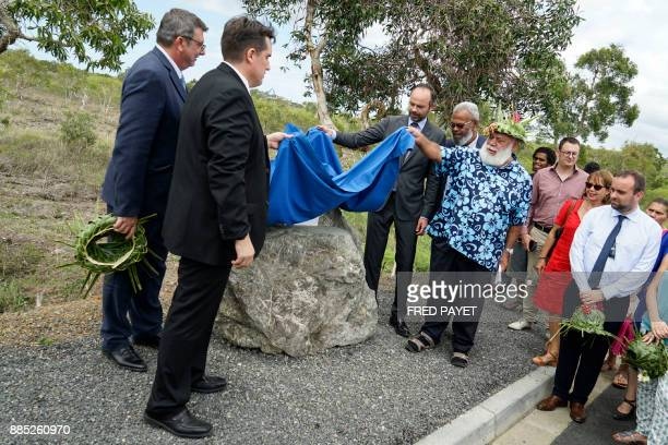 French Prime Minister Edouard Philippe and the president of the North Province of New Caledonia Paul Neaoutyine unveils a plaque during the...