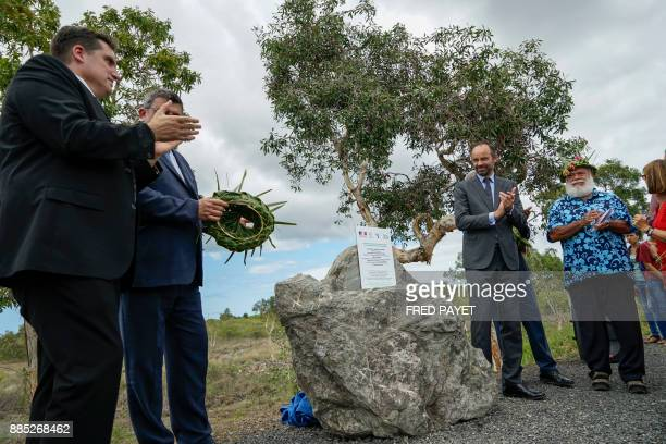 French Prime Minister Edouard Philippe and the president of the North Province of New Caledonia Paul Neaoutyine unveil a plaque during the...