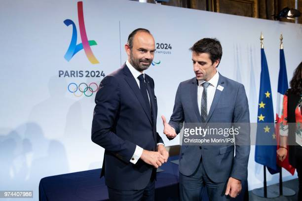 French Prime Minister Edouard Philippe and Tony Estanguet President of Paris 2024 shake hands during the ceremony of signing of joint funding...