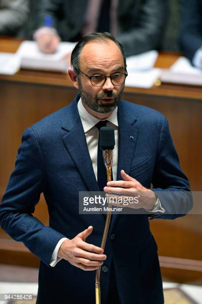 French Prime Minister Edouard Philippe answers deputies during the weekly session of questions to the government at Assemblee Nationale on April 10...