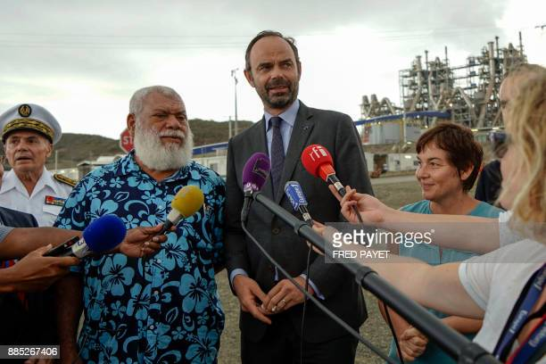 French Prime Minister Edouard Philippe answers journalists questions next to president of the North Province of New Caledonia Paul Neaoutyine and...