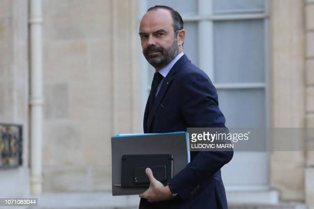 TOPSHOT French Prime Minister Edouard Philippe arrives for a meeting with French president on December 10 2018 at the Elysee palace in Paris as part...
