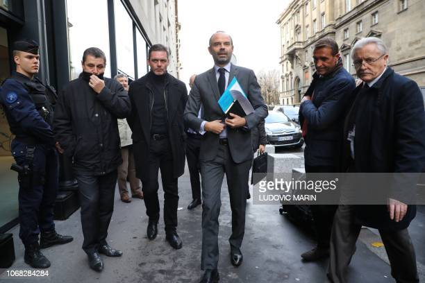 French Prime Minister Edouard Philippe arrives to announce the suspension on rising fuel taxes in Paris on December 4 a few days after the protests...