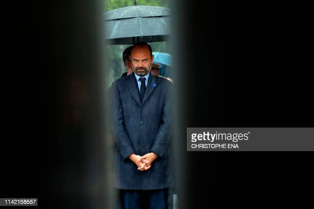 French Prime Minister Edouard Philippe attends a ceremony in front of the statue of General Charles de Gaulle marking the 74th anniversary of World...