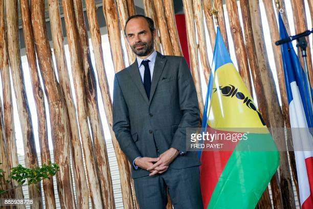 French Prime Minister Edouard Philippe attends a decoration ceremony within the inauguration of a high school in MontDore on December 5 2017 / AFP...