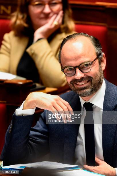 French Prime Minister Edouard Philippe attends a session of questions to the government on February 14 2018 at the French National Assembly in Paris...