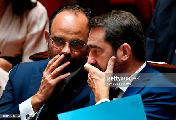 TOPSHOT French Prime Minister Edouard Philippe chats with French Minister of State for Relations with Parliament Christophe Castaner during a debate...