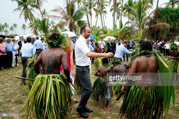 French Prime Minister Edouard Philippe dances as he takes part in a welcoming ceremony at the Case de la Grande Chefferie de Gaica to meet residents...