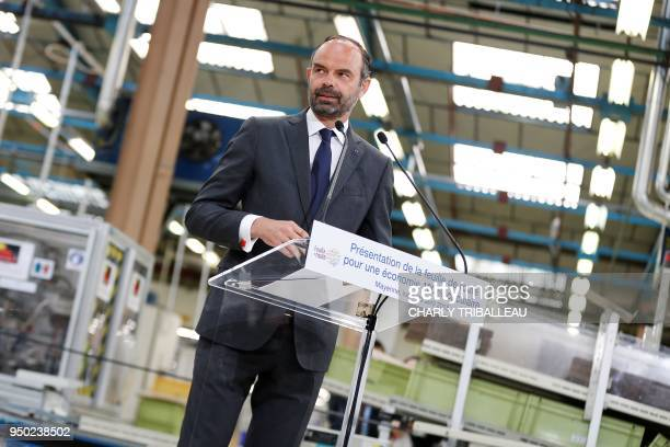 French Prime Minister Edouard Philippe delivers a speech during a visit to the French manufacturer SEB Moulinex's production plant in Mayenne western...