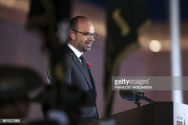 French Prime Minister Edouard Philippe delivers a speech on April 25 2018 during ceremonies marking the 100th anniversary of ANZAC day in...