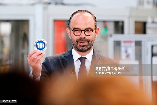 French Prime Minister Edouard Philippe delivers a speech to employees during a visit to the French manufacturer SEB's production plant in Mayenne...