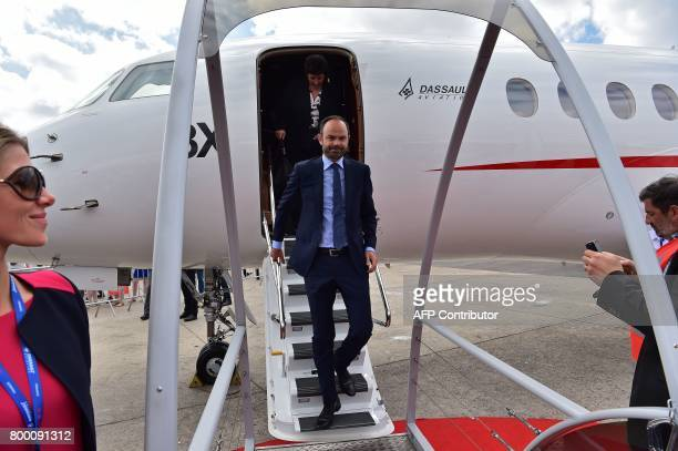 French Prime Minister Edouard Philippe disembarks from a Dassault Aviation Falcon 8X jet during a visit to the International Paris Air Show in Le...
