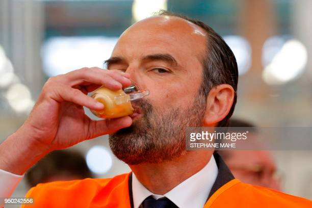 French Prime Minister Edouard Philippe drinks a coffee during a visit at the Groupe Seb Moulinex factory in Mayenne on April 23 2018