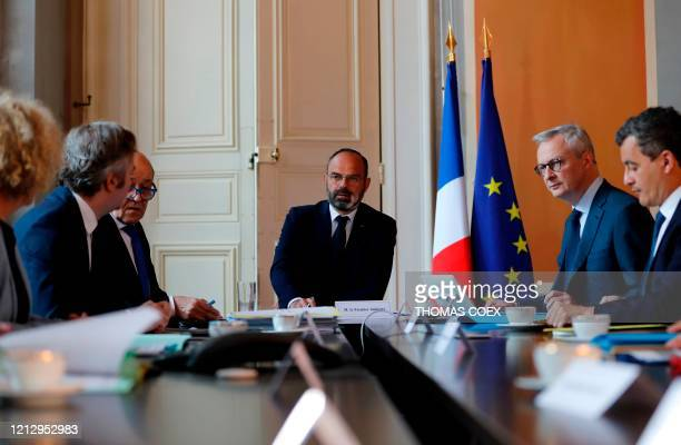 French Prime Minister Edouard Philippe flanked by French Economy and Finance Minister Bruno Le Maire and French Minister of Public Action and...