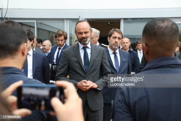 French Prime Minister Edouard Philippe flanked by French Interior Minister Christophe Castaner meets policemen of the Brigade Specialisee de Terrain...