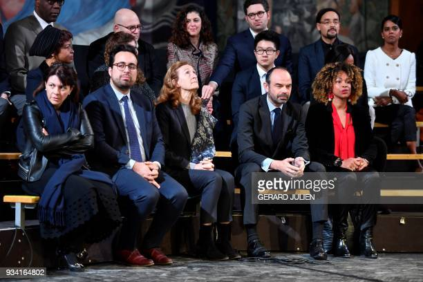French Prime Minister Edouard Philippe flanked by French Junior Minister for the Digital Sector Mounir Mahjoubi French Justice Minister Nicole...
