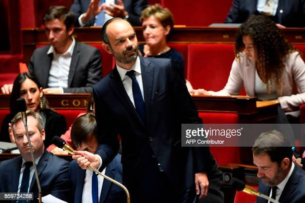 French Prime Minister Edouard Philippe flanked by French Junior Foreign Affairs Minister JeanBaptiste Lemoyne and French Junior Minister for the...