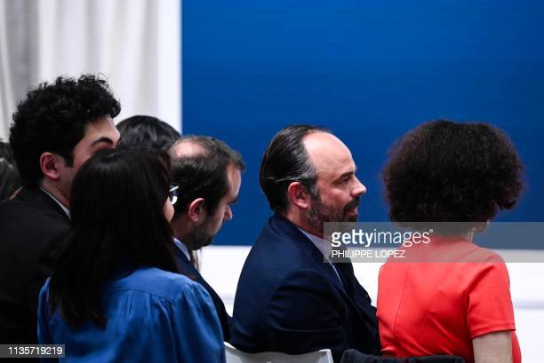 French Prime Minister Edouard Philippe , flanked by French Junior Minister to the Minister of Ecological and Solidarity Transition Emmanuelle Wargon...