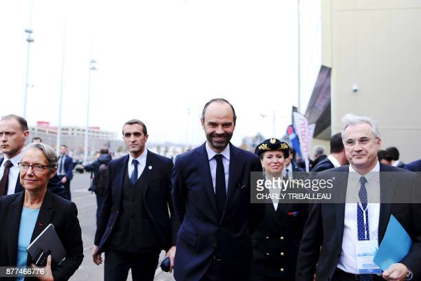French Prime Minister Edouard Philippe flanked by French Minister of Transport Elisabeth Borne leaves the National Convention of the Sea on November...