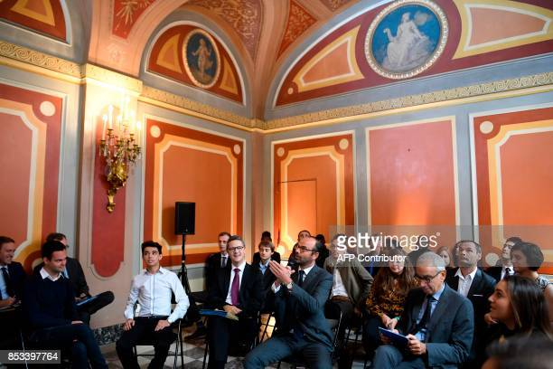 French Prime Minister Edouard Philippe flanked by Prime Minister's Adviser for Social Employment and Formation speaks during a report on the Grand...