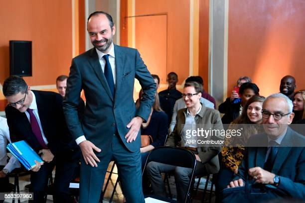 French Prime Minister Edouard Philippe flanked by Prime Minister's Adviser for Social Employment and Formation reacts during a report on the Grand...