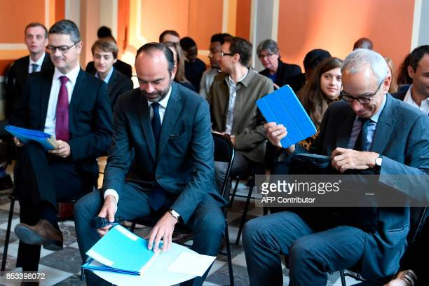 French Prime Minister Edouard Philippe flanked by Prime Minister's Adviser for Social Employment and Formation attends a report on the Grand...