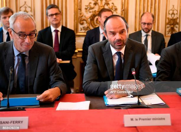 French Prime Minister Edouard Philippe flanked by Prime Minister's Adviser for Social Employment and Formation reacts speaks during a report by...