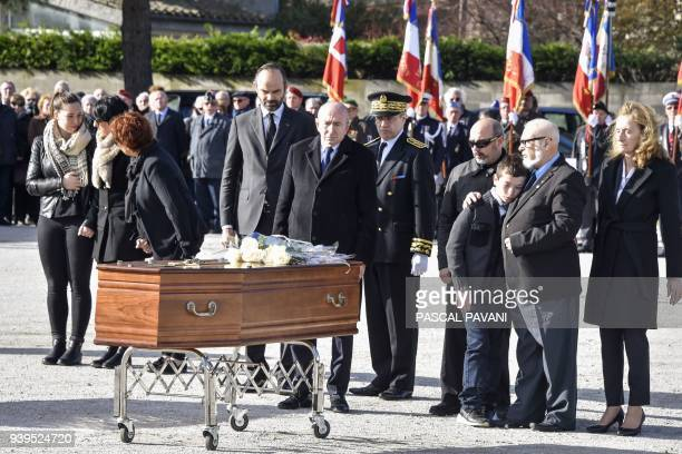 French Prime Minister Edouard Philippe French Interior Minister Gerard Collomb and French Justice Minister Nicole Belloubet stand with family members...