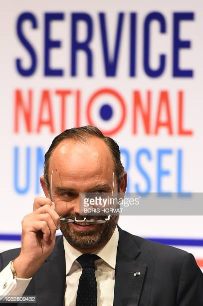 French Prime Minister Edouard Philippe gestures as he addresses an audience in Avignon on September 13 while launching a series of consultations on...
