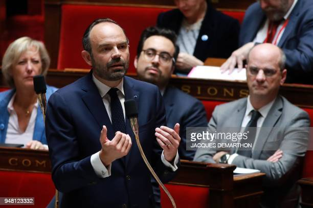 French Prime Minister Edouard Philippe gestures as he speaks during a session of questions to the government at the French National Assembly in Paris...
