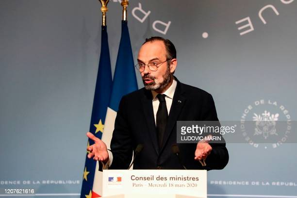 French Prime Minister Edouard Philippe gives a press after a cabinet meeting in Paris on March 18 held to draft a law to confirm delay of second...