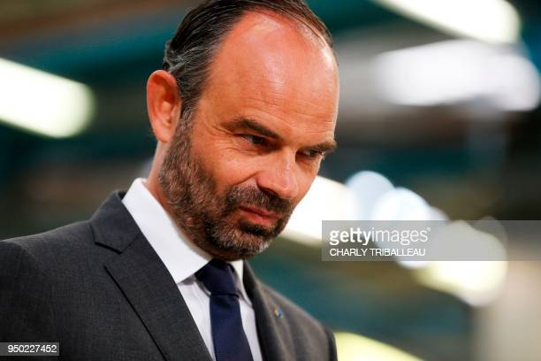 French Prime Minister Edouard Philippe is pictured during a visit to the French manufacturer SEB's production plant in Mayenne western France on...